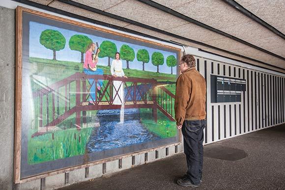 Maleri af Børge Flyvholm og Peter Graversen. Billedet er beskyttet af et stort stykke plexiglas.