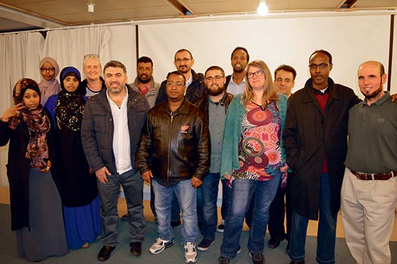Bestyrelsen i Gellerupparken med den nye formand, Youssef Abdul Kader, som nummer tre fra venstre.